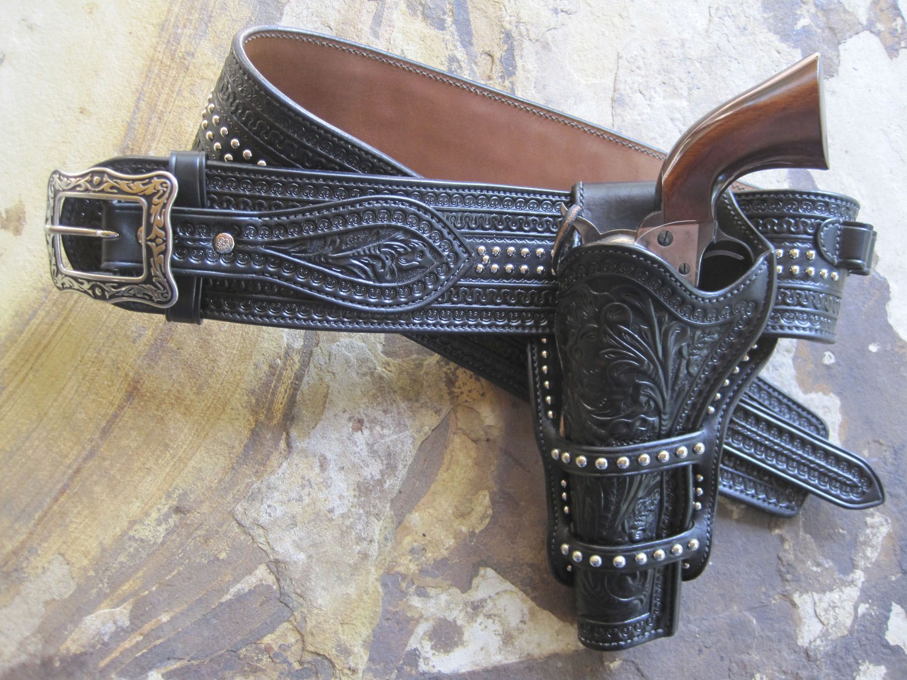 See custom leather shoulder holsters
